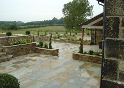 Natural sandstone paving with random walling. Barn Conversion, Wrightington, Lancashire.