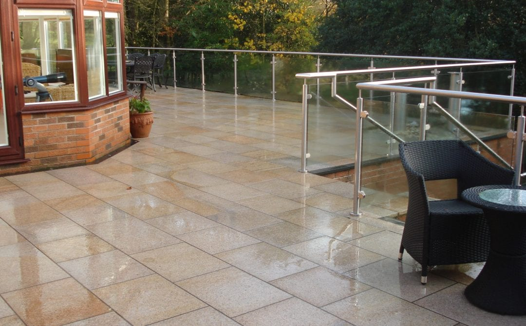 Contemporary Granite Balcony with Stainless steel glass balustrade.